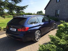 BMW F31 330D Touring M-sport in individual tanzanite blue.