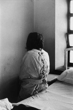 Patient in mental hospital wearing a restraining garment. (via LIFE)