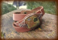 LOVE! This triple wrap, soft leather bracelet has been lightly distressed and adorned with a gorgeous, copper herringbone captured, rhyolit...