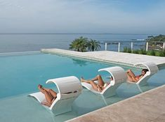 Ledge Lounger in-pool furniture is the perfect finishing touch to any pool scene. Stylish, durable, and comfortable, Ledge Lounger adds instant luxury to any tanning ledge or sun shelf. Pictured here: Chaise Deep with attachable Shade. Backyard Pool Designs, Backyard Pergola, Swimming Pool Designs, Pergola Ideas, Pergola Kits, Backyard Pool Landscaping, Patio Design, Landscaping Ideas, Ledge Lounger
