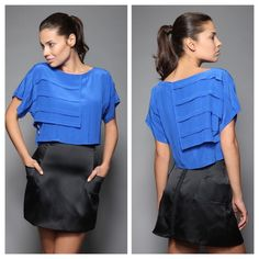 Mischen silk layered crop blouse blue size 0 MISCHEN. Color is a VIBRANT royal blue. This is a gorgeous 100% silk georgette short sleeve roundneck blouse w/pleat detail, semi-attached layered panel, cropped hem + buttons w/rhinestones. Button down side closure. 18 inches from shoulder to hem. Measurements were taken from a size 2 (however top being sold is a size 0*). Model pictured is 5'11 - bust: 35 inches, waist: 25 inches, hips: 35 inches. Other model pictured (psyche, it's just me) is…