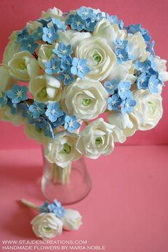 wedding floral arrangements with forget me nots - I'd like this in white and lavender :)