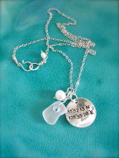 Kim S...this is for you!!    everything I like - silver, seaglass and pearls. I'd want the co-ords for Sanibel Island tho.