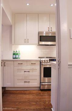 white ikea grimslov shaker cabinets, white quartz countertop