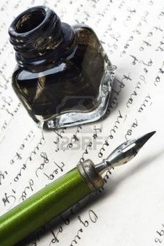 vintage writing tools - nib and ink bottle - on a letter