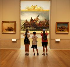 Children stand before Emanuel Leutze's iconic 'Washington Crossing the Delaware' at the Metropolitan Museum of Art (NYC).