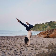 Doing handstands because we've given up finding hot water at the Hot Water Beach! #wheresthehotwater