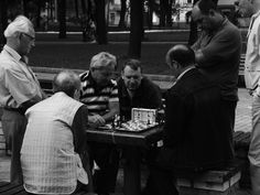 Chess players in the park.