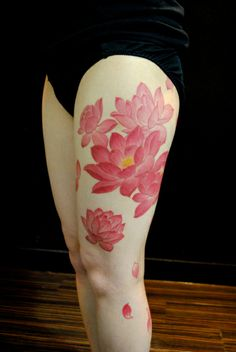 Red Asian style #lotus flower #tattoo on the leg