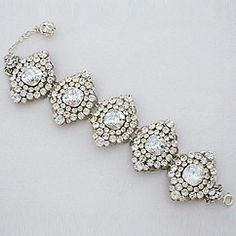 Erin Cole couture bridal jewelry. Crystal brooch link bridal bracelet is couture wrist candy for the bride. Spectacular jewelry creating unique brides.
