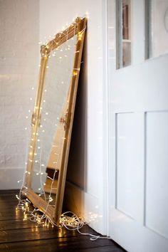 Every girl should have a mirror in their bedroom, and adding lights around it would be super cute.