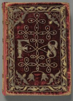 "Book of Common Prayer"" (London: Christopher Barker, 1586). Embroidered with silver cord and thread, this rare surviving example of textile binding features red velvet covers decorated with spangles. Although the exact date of this binding is unknown, it closely resembles the embroidered velvet Bible presented by the same printer, Christopher Barker, to Queen Elizabeth I as a New Year's gift in 1584."