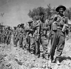 Men of No. 11 Pl, B Coy. Seaforth Highlanders of Canada, in the vicinity of Pozzo Alto, Italy at the end of August, 1944.