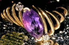 Check out this item in my Etsy shop https://www.etsy.com/listing/469377229/amethyst-diamond-10k-gold-ring-size-75