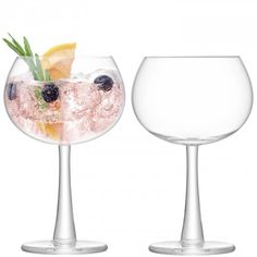 GIN Balloon Glass x 2 The thick foot and subtly flared stem add distinctive detail to this gin balloon glass. Mouthblown by skilled artisans, it is designed with a wide bowl that will enhance the scent of gin's delicate botanicals. Mix with other pieces in this handmade collection to create a specialist gin bar.