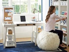 Why Kids Can't Sit Still & How To Help - white desk, blue rug, baskets on shelves,