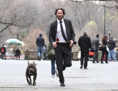Keanu Reeves Photos Photos - A beat-up and bloody Keanu Reeves can be seen doing some intense running scenes with his pitbull costar in Manhattan's Central Park for 'John Wick 2' on December 21st, 2015.