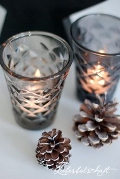 Candle light & pine cones
