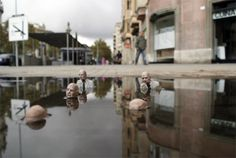 Isaac Cordal is a sculpture artist from Galicia. His sculptures take the form of little people sculpted from concrete in 'real' situations. He is sympathetic toward his little people and we empathise with their situations, their leisure time, their waiting for buses and their more tragic moments.    His sculptures can be found in gutters, on top of buildings, on top of bus shelters – in many unusual and unlikely places in the capital.