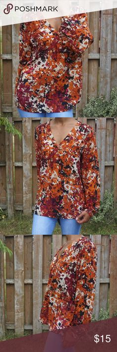 Floral Print Chiffon Blouse Floral print V-neck Chiffon Sheer Two pockets in the front Pleat down the middle front  Willi Smith 100% polyester Bust: 22 inches  Length: 26 3/4 inches  Sleeve length: 24 3/4 inches Ruched shoulders Willi Smith Tops Blouses
