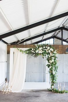 wedding ceremony arbor - photo by Wesley Vorster Photography http://ruffledblog.com/timeless-romance-wedding-inspiration More