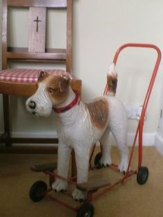 READY TO ROLL! Vintage wire hair fox terrier on wheels! Wheeeee! (English Triang, Circa 1950's)