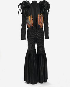 """Brian Eno's costume by Carol McNicoll, 1972: rayon and feathers, satin and silver thread. Seen in the inner sleeve of 2nd Roxy Music album """"For Your Pleasure"""", 1973."""