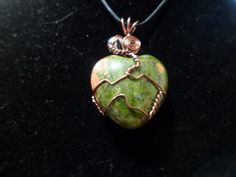 This is a Unakite Heart wrapped in Antique Copper non-tarnish wire with a tourmalated quartz bead. The Necklace is about 2 inches from the base of the heart to the top of the wire cord loop. Comes with cord and mesh bag to protect the necklace, to be worn as a necklace.