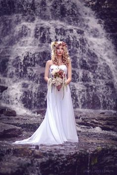 In a waterfall, trash the dress reminds me of Taylor Swift....