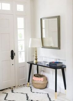 Yes, this entryway is beautiful. No, it didn't cost us a fortune. Learn about our five favorite Ikea hacks on Pinterest...