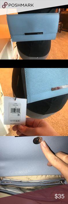 NWT Calvin Klein's Evening Clutch NWT evening clutch my Calvin Klein. Super cute bag that can be a clutch of Shoulder Bag. Calvin Klein Bags Clutches & Wristlets