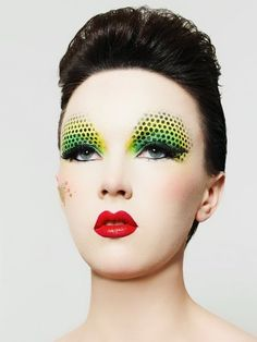 From make-up artist Kelly Budd comes this stunning green and yellow eye makeup with black dots.