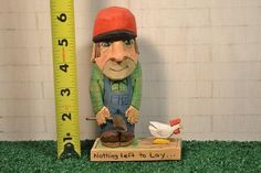 Chicken Farmer with ax and chicken wood by MADellingerCarving