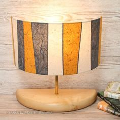 Wide half lamp in grey and mustard stitched paper stripes by Sarah Walker