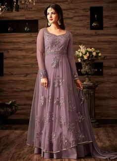 Glossy Net Floor Length Anarkali Suit Genuine magnificence will come out through the dressing style and design with this purple net floor length anarkali suit. The embroidered, lace and resham work looks chic and great for festival, party and wedding. Comes with matching bottom and dupatta.