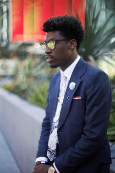 Menswear influencer  Donovan Briggs  Los Angeles, CA  Sunglasses: TOMS Accessories: Pocke Square Clothing
