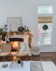 Natural and neutral holiday decor. Mantle decorations with garland, black and white plaid and window wreaths.