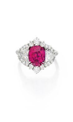 Ruby and Diamond Ring. Set with a cushion-shaped ruby weighing 4.05 carats, between two half-moon step-cut diamonds weighing 0.66 carat each, embellished with brilliant-cut diamonds, size 5¾.