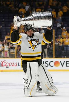 Penguins Mobile: NASHVILLE, TN - JUNE 11: Marc-Andre Fleury #29 of the Pittsburgh Penguins celebrates with the Stanley Cup trophy after defeating the Nashville Predators 2-0 in Game Six of the 2017 NHL Stanley Cup Final at the Bridgestone Arena on June 11