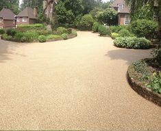 Clearstone Resin Bound Gravel. Beautiful surface for driveway with curved herbaceous flower boarders on Wentworth Estate, Surrey.