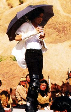 Michael Jackson  I didn't realize that even around this time (while filming black or white) that he had to use an umbrella. I learn new things about Michel every day.