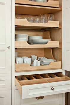 Organized kitchen cabinets to drool over by McGill Design Group.