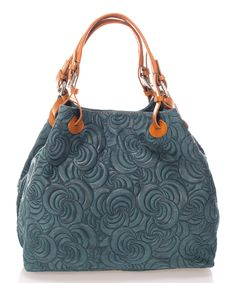 Embossed swirls add elegant flair to this chic leather hobo. Its spacious interior boasts a variety of pockets and compartments to keep your essentials organized.13'' W x 11'' H x 6.3'' D6.3'' handle drop43.3'' strap dropLeatherLinedMagnetic snap closureThree compartmentsInterior: one zip and one slip pocketMade in ItalyShipping note: This item is shipping from Italy. Allow extra time for its journey to you.
