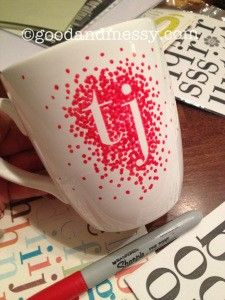 Using dollar store letter stickers on a white coffee mug, use a sharpie and make dots then remove the sticker and bake at 350 degrees for 30 minutes.     Be sure to use oil-based Sharpies and enamel-based paints made specifically for ceramics to make th…
