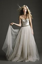 Magnificent fully paneled corseted gown in luminous 'Pearl' 'featuring antique stone tulle skirt.   Johanna Johnson