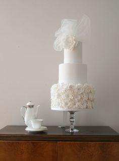 white wedding cake with veil