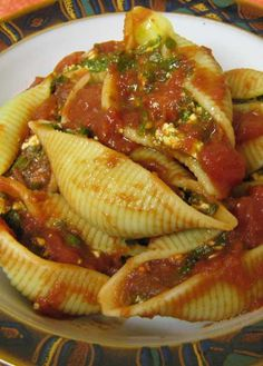 Recipe for Spinach Stuffed Shells - Although these stuffed shells seem to scream indulgence, the nutrition facts prove otherwise. The key to slimming down the fat and calorie content of this dish is choosing lighter options in the cheese aisle.