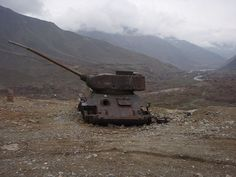 30 Abandoned Tanks and Armoured Vehicles wreck of this T-34-85 tank silently overlooks a misty river valley in Afghanistan, near the tomb of Northern Alliance leader Ahmad Shah Massoud.  As this article points out, it's not the only abandoned military vehicle guarding the grave