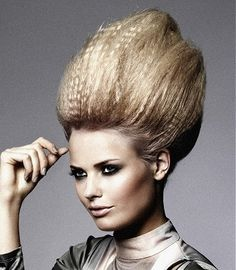 A long blonde straight coloured frizzy updo beehive hairstyle by Gooseberry