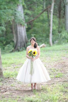 I love everything about this photo..the dress, the flowers and the location.